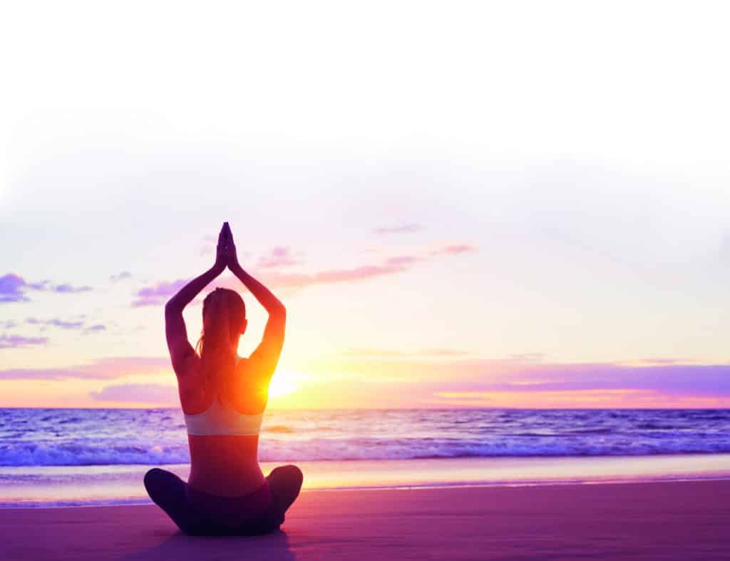 Young,Healthy,Woman,Practicing,Yoga,On,The,Beach,At,Sunset